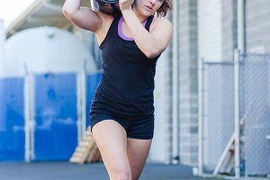 Crossfit Barrel Carry - Young Woman