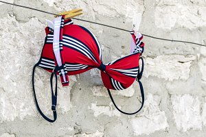 Red swimsuit on clothesline