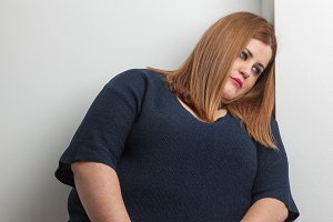 Depressed overweight woman