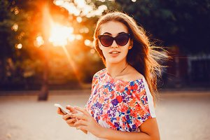 young pretty girl using smartphone
