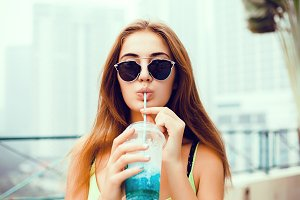 young girl drink smoothie