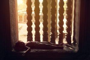 homeless boy sleeping on wall
