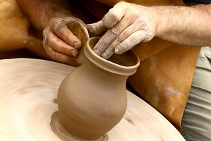 Potter making clay jug
