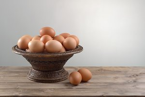 chicken eggs in a wicker bowl
