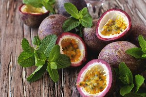 juicy fruit Granadilla with mint on a wooden table