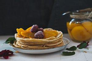 Raspberry and peach thin pancakes.