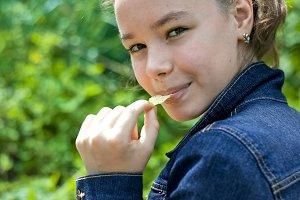 Girl eating crisps