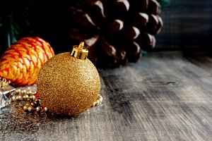 Christmas decorations on a background of trees and cones