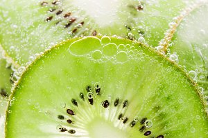 Background fruit kiwi with bubbles
