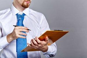 Businessman hold folder and pen