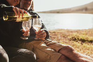 Couple enjoying wine on camping trip