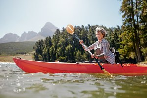 Mature woman paddling a kayak