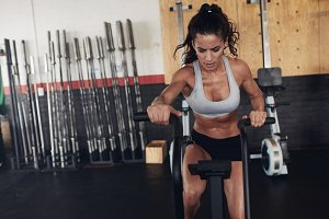Fit young female working out on gym