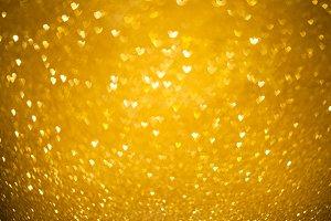 Hearts gold bokeh