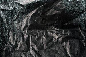 Crumpled dark paper texture