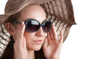 woman in a hat and sunglasses