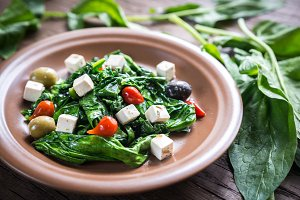 Spinach with cheese and olives