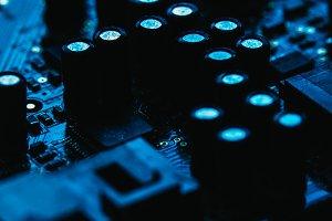 Computer motherboard closeup blue color on dark background