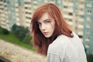 red-haired girl on the roof