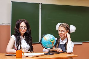 Teacher and pupil in geography class