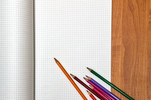 Colored pencils lie on notebook