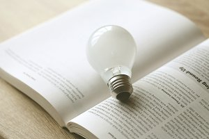 light bulb on open book