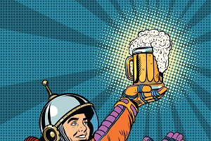 retro astronaut and a mug of beer