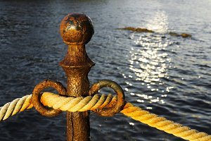 vintage rope on rustic bollard