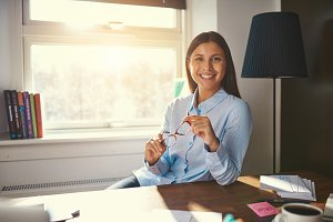 Relaxed business woman sitting at desk