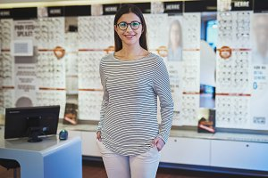 Cheerful woman in eyeglasses and striped shirt