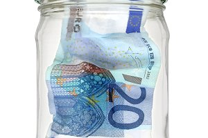 Banknote 20 euro in glass jar