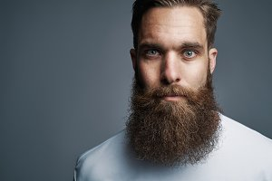 Close up on serious man with long beard