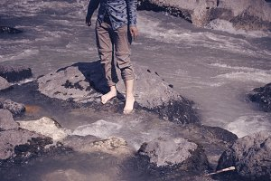 Bare feet in a mountain river.