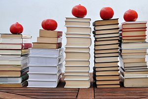 piles of books and tomatoes