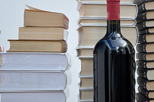 pile of books and wine