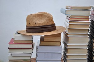 piles of books and hat