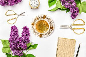Coffee and lilac flowers
