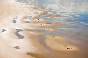 steps on the wet sand