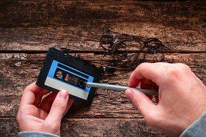 man rewind a cassette tape