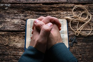 man praying on the bible