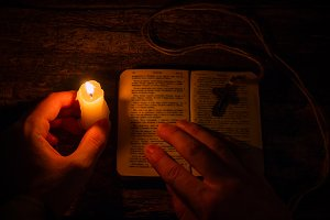 pray by candlelight