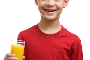 Happy child holds glass of juice