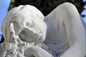 sculpture woman resting in the cemetery
