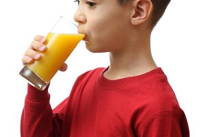 Child drinks orange juice
