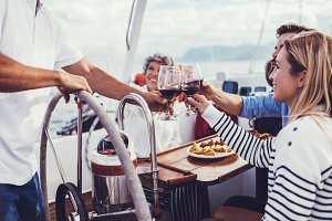 Woman on yacht toasting wine