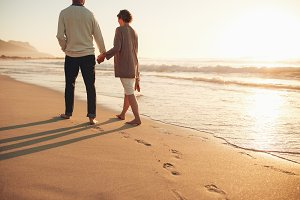Senior couple walking along the sea