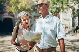 Mature couple using a map