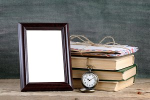 Photo frame and pile of old books