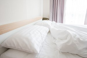 bed with crumpled bed sheet