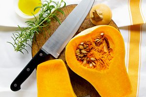 butternut squash and and chef knife.